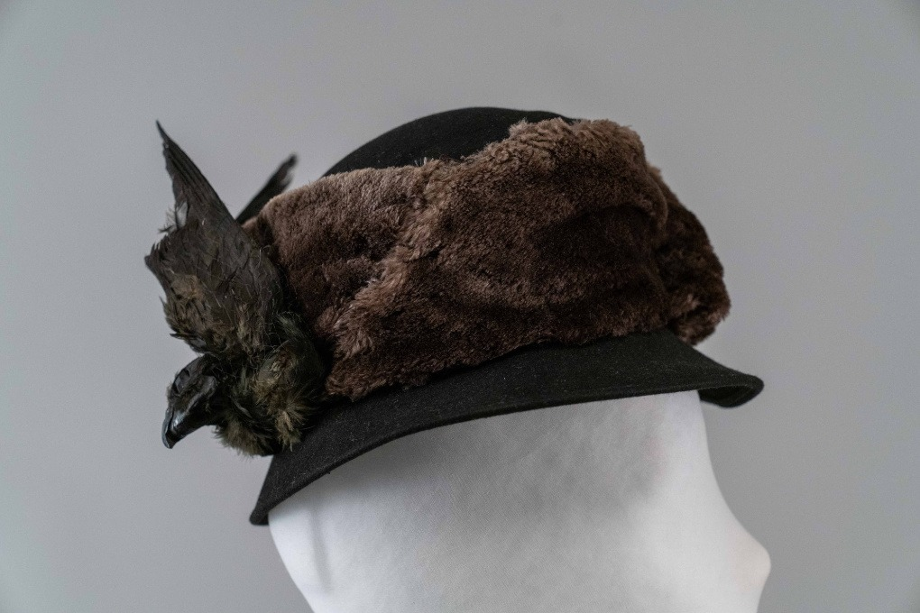 Photo of Black High Chapeau trimmed with Brown Fur and a Bird