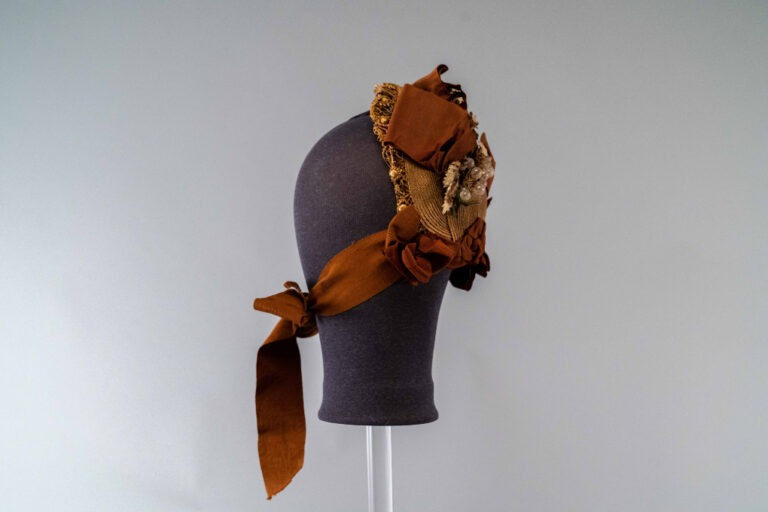 Photo of Small Natural Straw Shepherdess Hat Trimmed with Taffeta and Glass Grapes