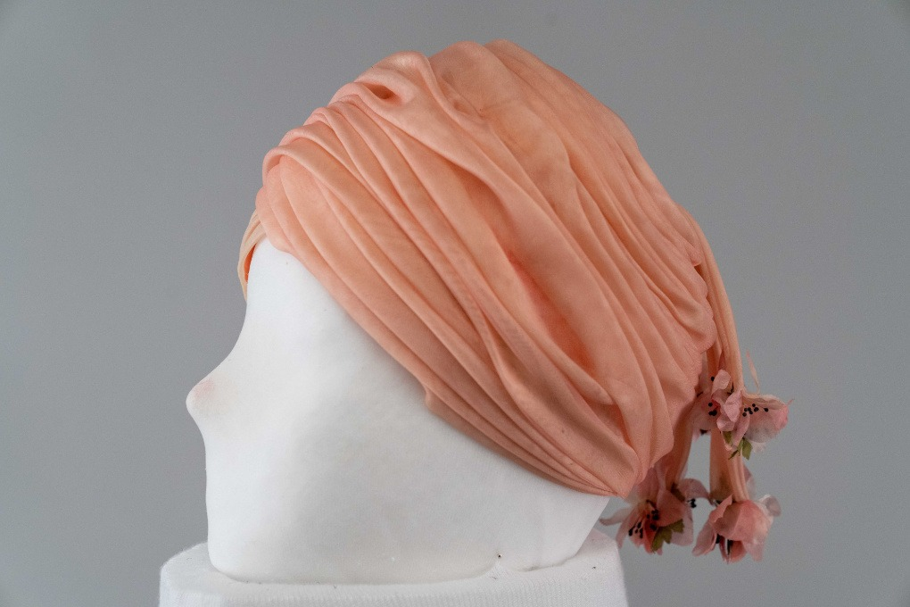 Photo of Pink Organza Draped Turban with Streamers and Flowers