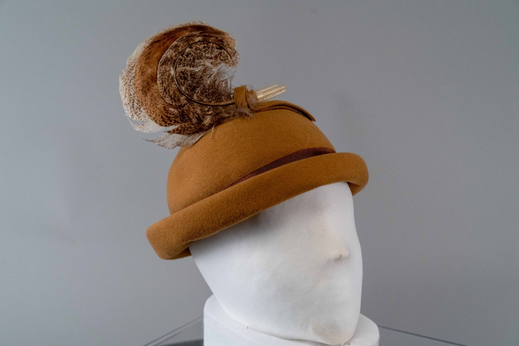 Photo of Camel Colored Rolled Brim Bowler with Curled Turkey Feather Trim