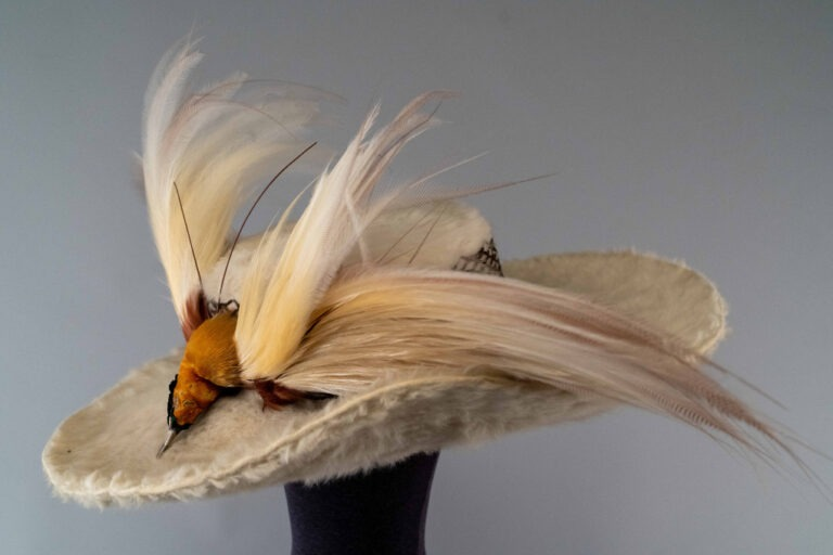 Photo of White Beaver Fur Hat trimmed with a Bird-of-Paradise
