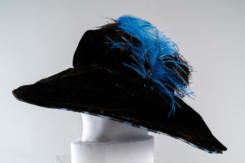 Photo of Black Velvet Mushroom Hat with Black Ostrich Plumes and Under Brim of Royal Blue Taffeta